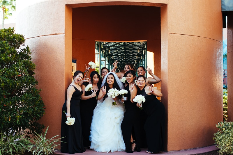 Bride and Bridemaids taking a group shot at the Orlando Disney Swan and Dolphin Resort