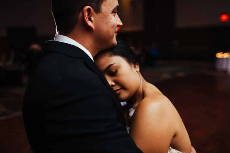Bride laying her head on your Groom as they dance solo together at the Orlando Disney Swan and Dolphin Resort