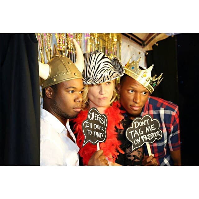 guests wearing props in a photo booth