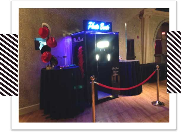 photo booth with velvet rope and neon sign