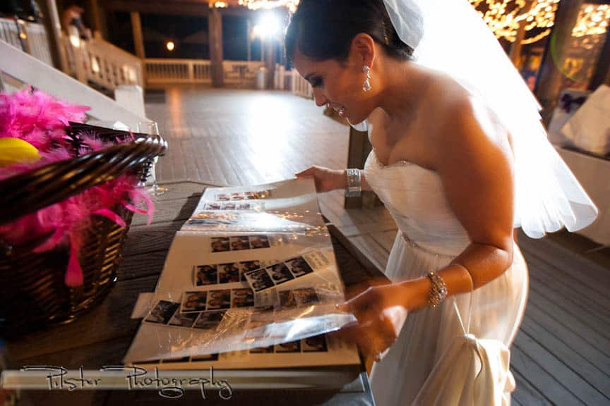 bride looking at photo booth scrapbook