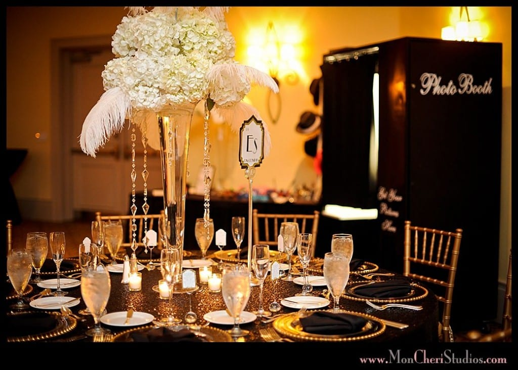 black classic photo booth in background of reception table