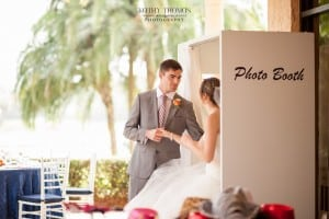 bride and groom inside photo booth