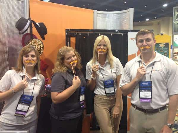 trade show reps posing with mustaches