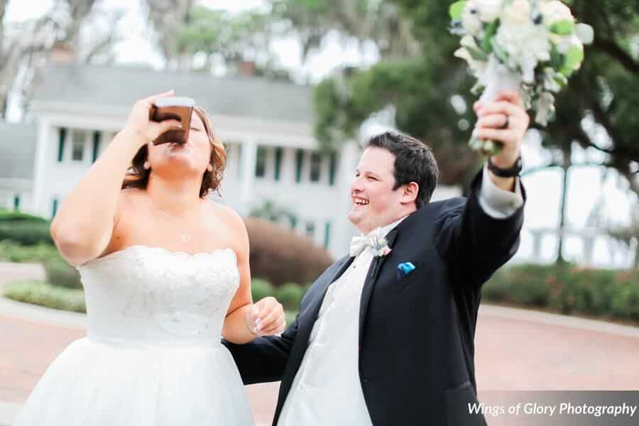 Classic black photo booth at Cypress Grove Estate House wedding bride and groom drinking a flask