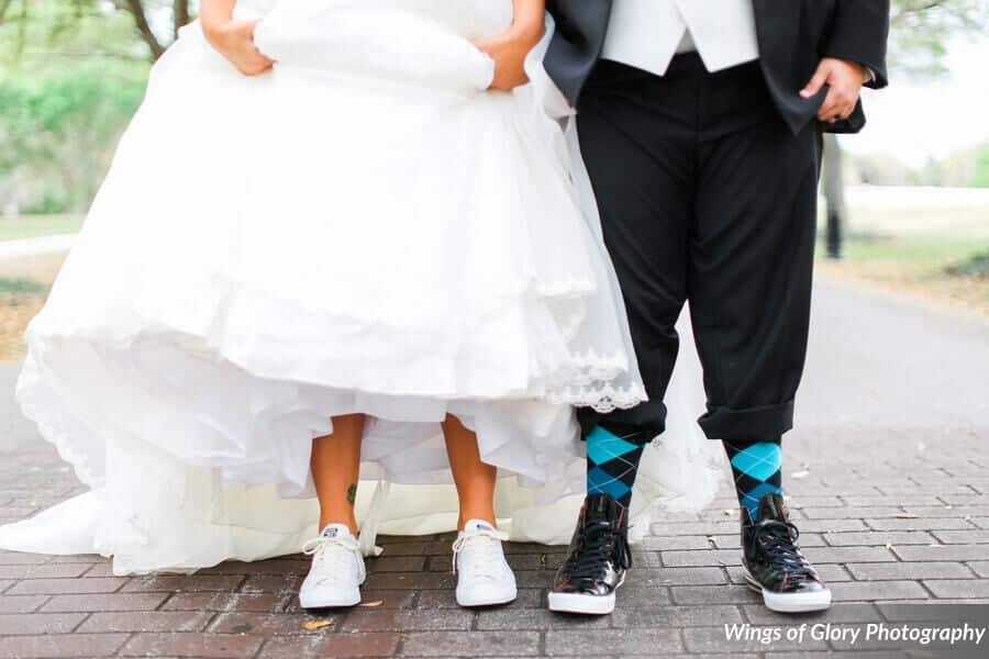 bride and groom showing their sneakers