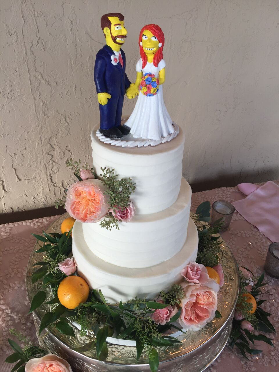 Black open air photo booth at Mission Inn Resort wedding with Homer Simpson prop and simpson character cake toppers