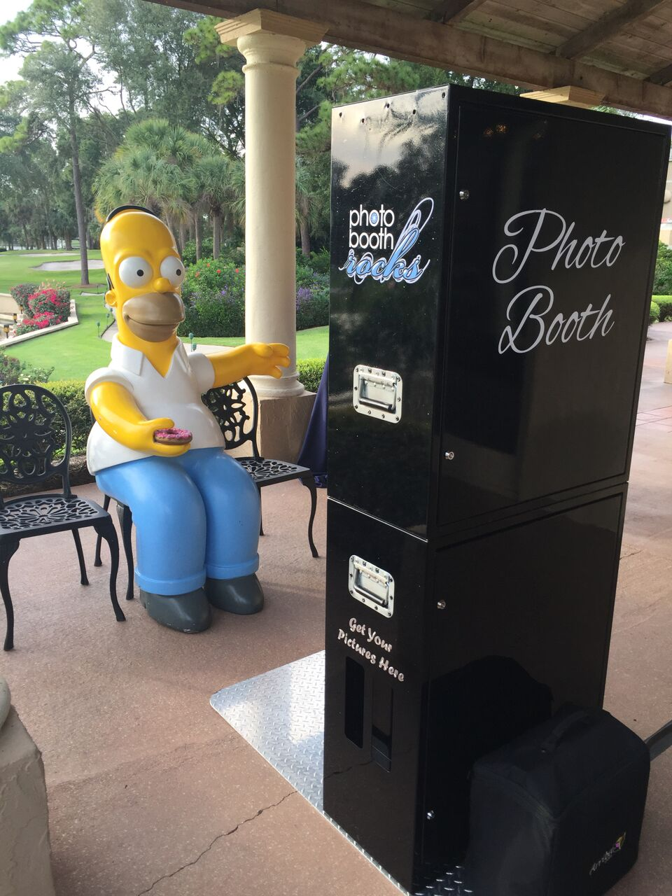 Black open air photo booth at Mission Inn Resort wedding with Homer Simpson prop