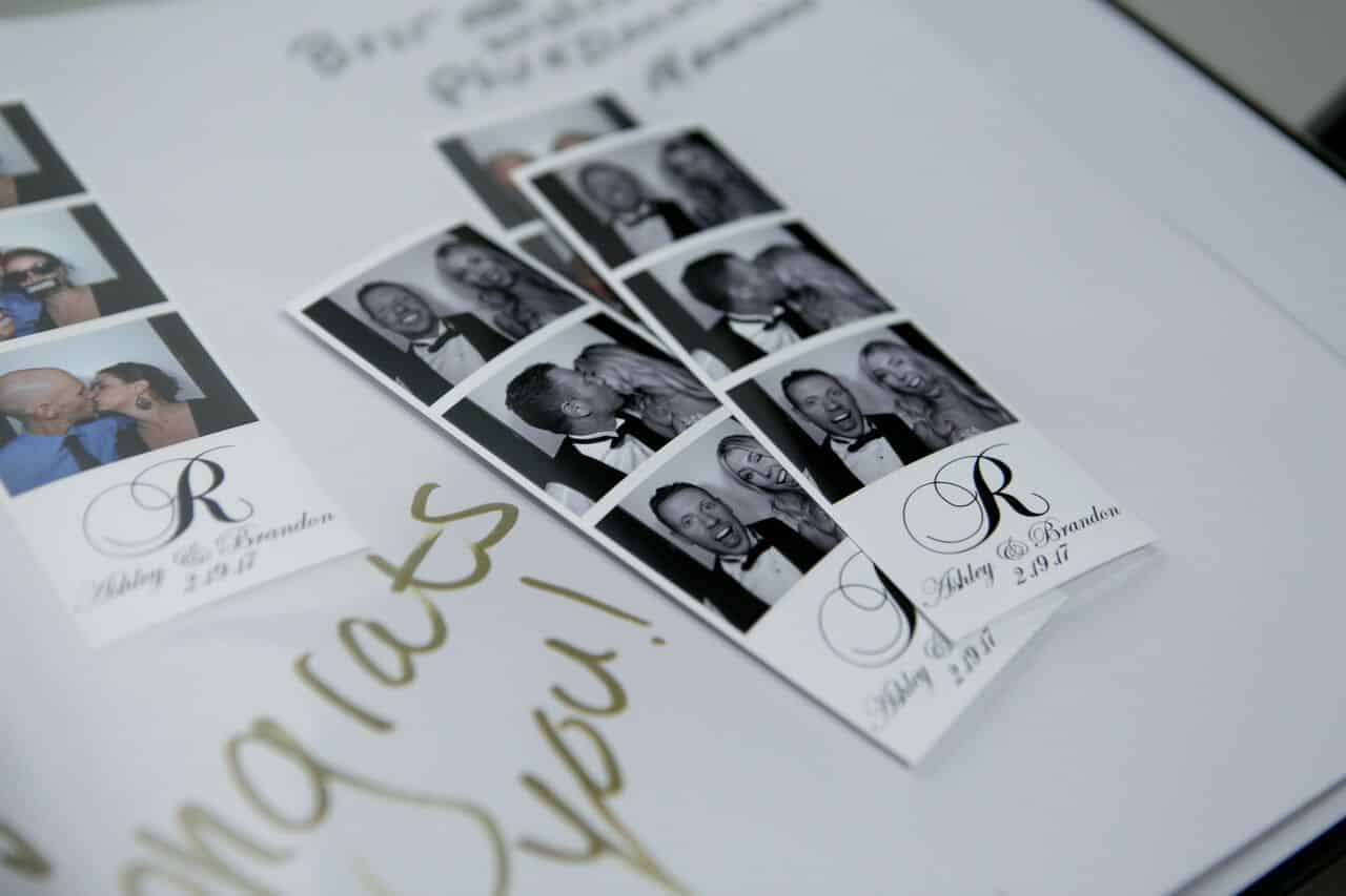 classic black photo booth at Bella Collina wedding scrapbook photos of couple