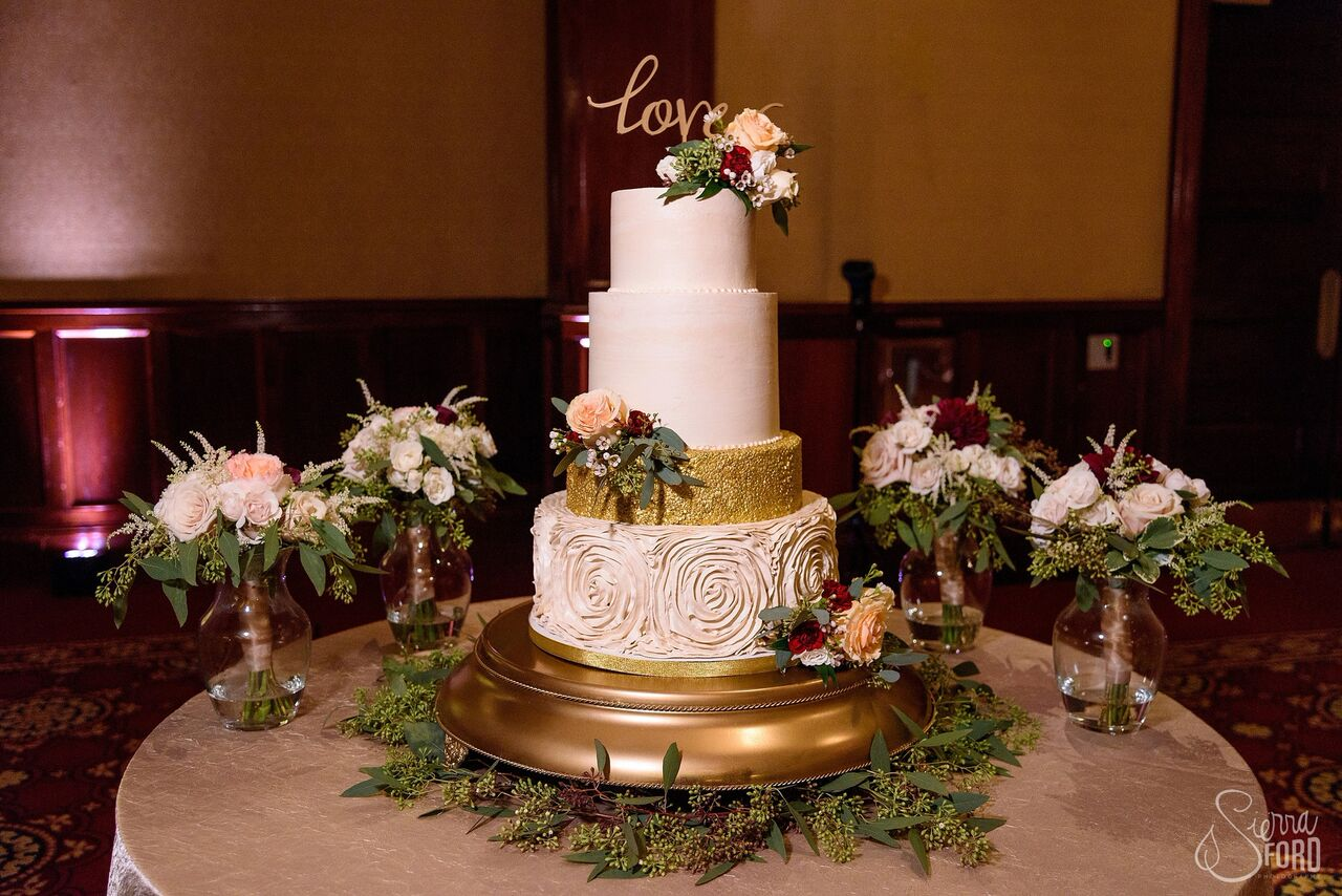 black printz photo booth with gold glitter backdrop at Ballroom at Church Street wedding cake with blush pink uplights