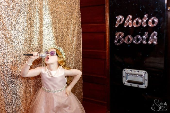 black printz photo booth with gold glitter backdrop at Ballroom at Church Street wedding