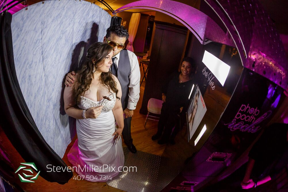 photo booth rocks black printz photo booth at Crystal Ballroom wedding bride and groom posing with props