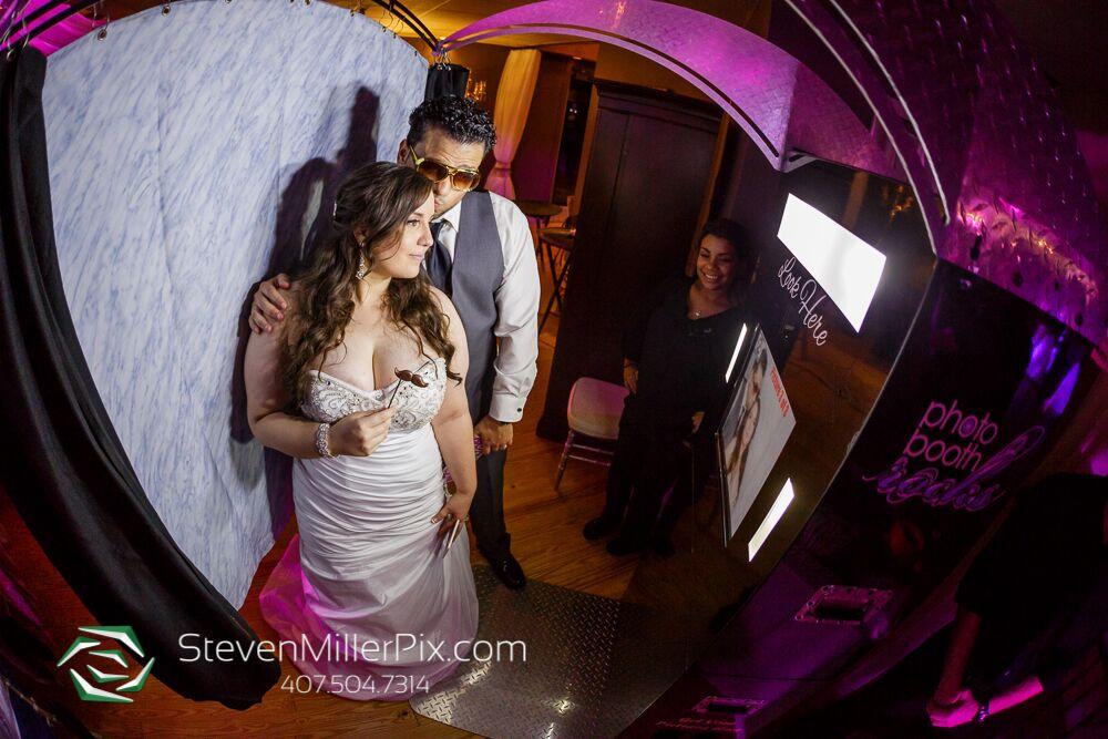 photo booth rocks black printz photo booth at Crystal Ballroom wedding bride and groom posing with props