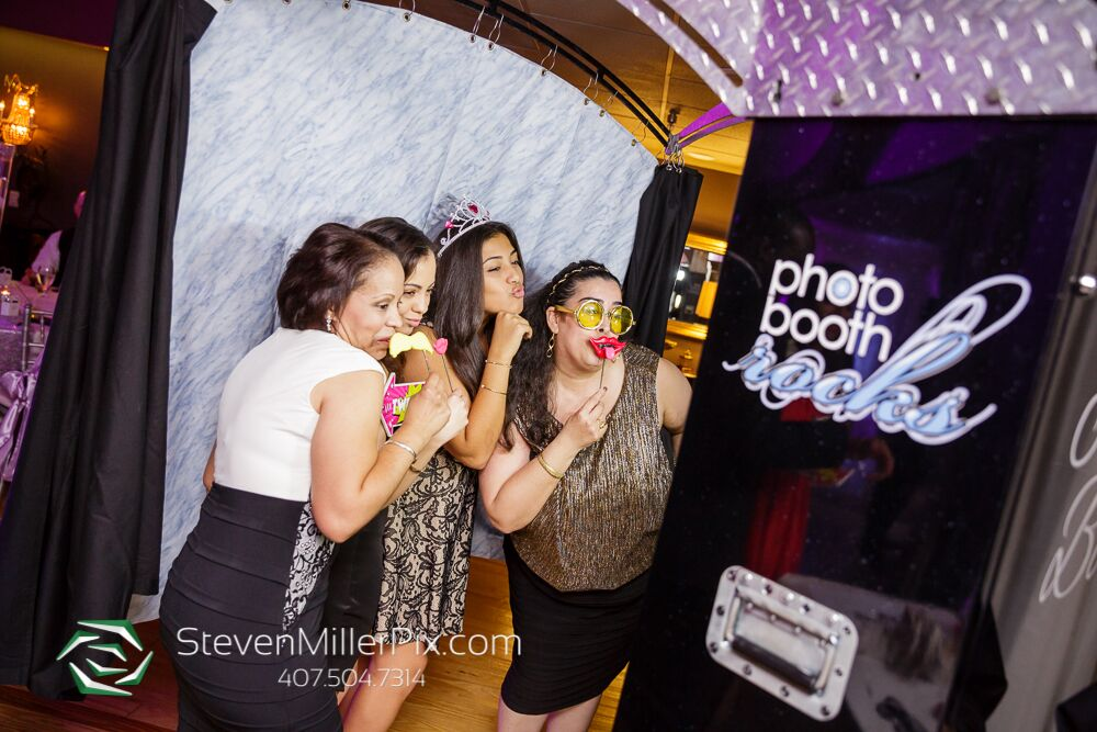 photo booth rocks black printz photo booth at Crystal Ballroom wedding guests posing with props
