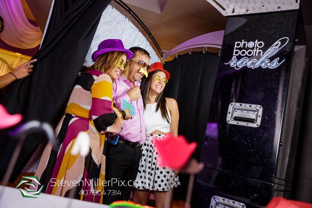 photo booth rocks black printz photo booth at Crystal Ballroom wedding guests posing with props