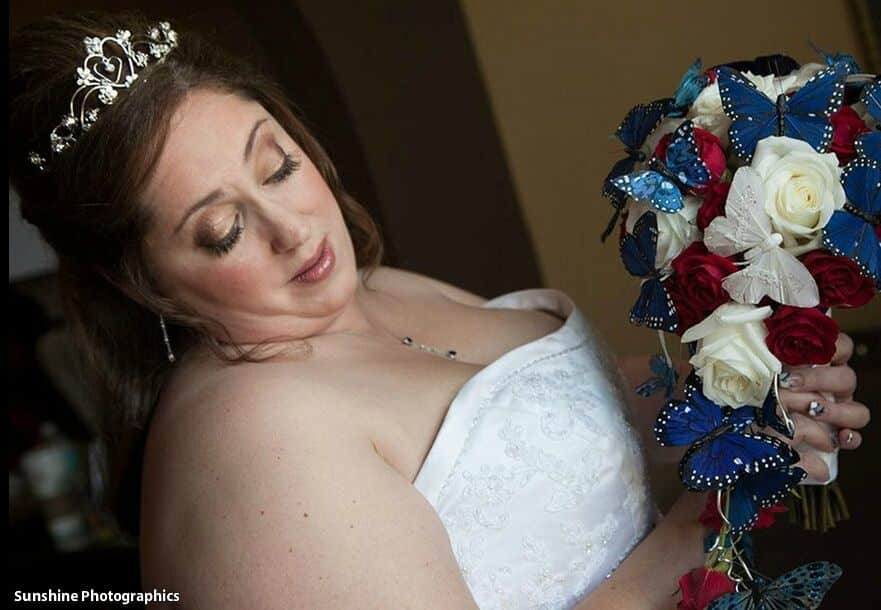 classic black photo booth at The White Room wedding bride with red, white and blue bouquet