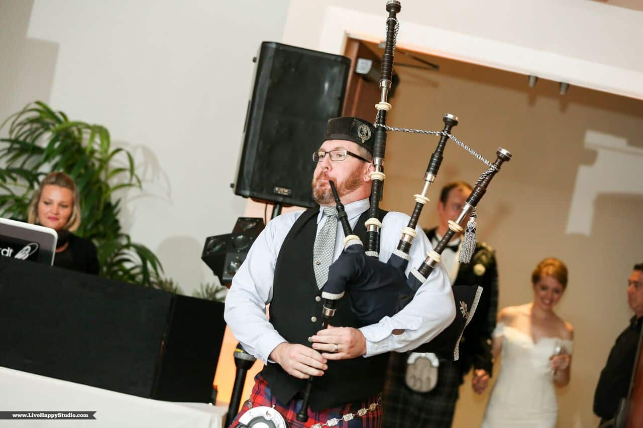 black printz booth at scottish inspired wedding at The Golden Bear Club traditional bagpipe player