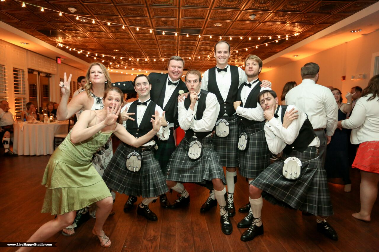 black printz booth at scottish inspired wedding at The Golden Bear Club groomsmen posing in kilits