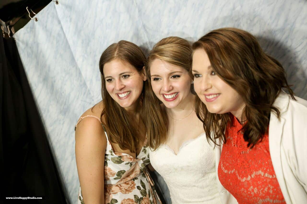 black printz booth at scottish inspired wedding at The Golden Bear Club bride posing with friends in booth
