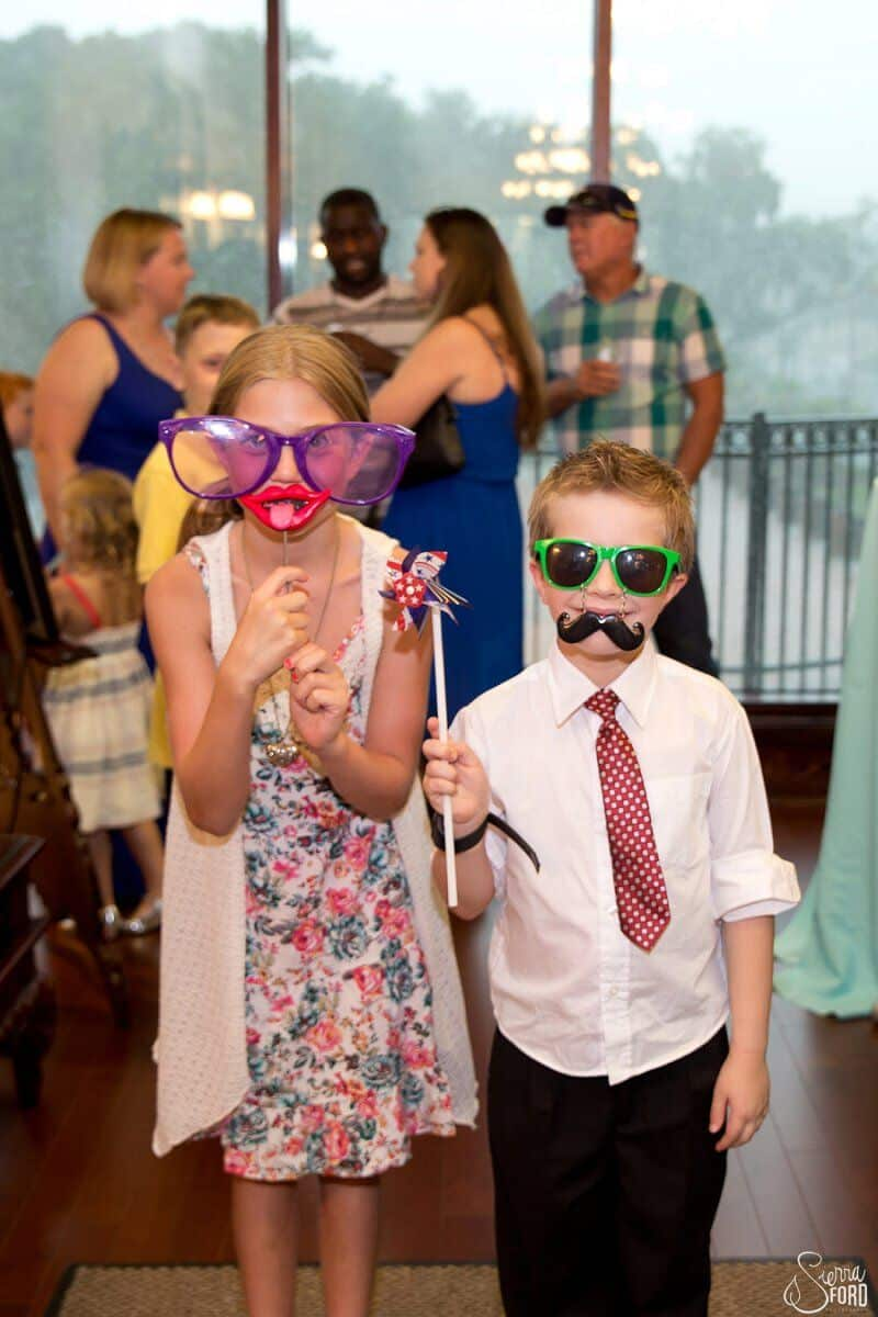 classic photo booth props on children at Tavares Pavilion on the Lake wedding