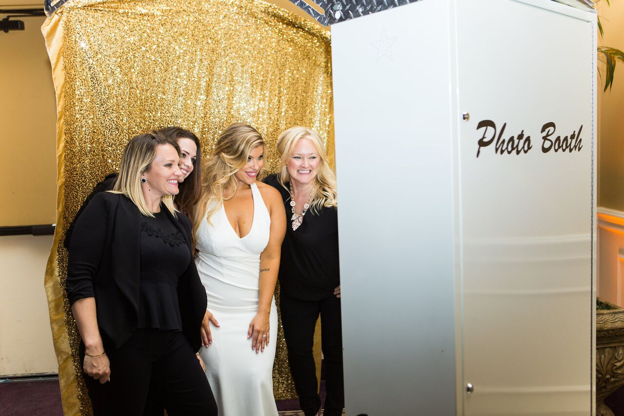 white printz photo booth with gold backrop at Holy Trinity Reception Center wedding