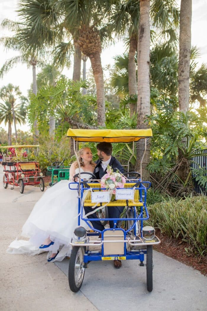 photo booth rocks at hyatt regency grand cypress wedding couple on bike
