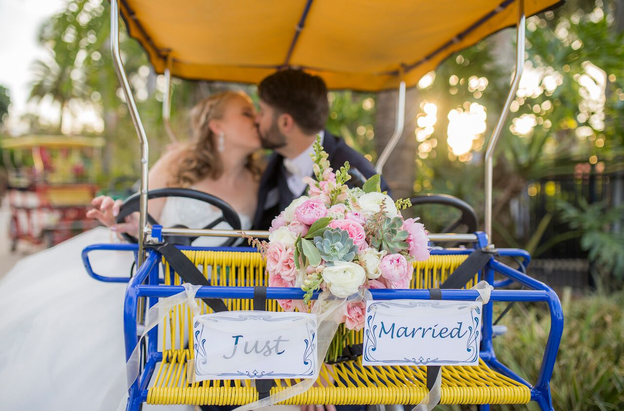 photo booth rocks at hyatt regency grand cypress wedding couple kissing on bike