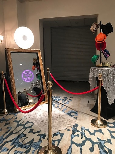mirror booth with ropes and carpet