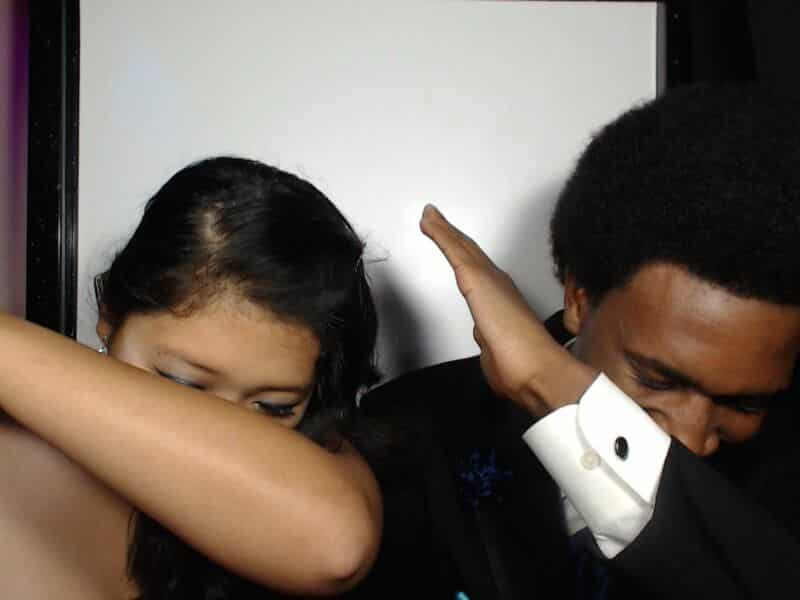 teenagers dabbing in photo booth