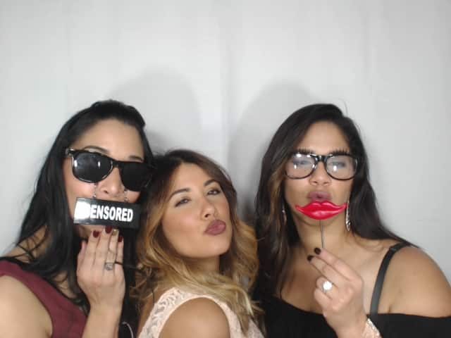 three girls with lip photo booth prop