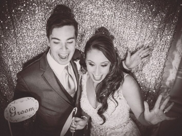 bride and groom posing in photo booth