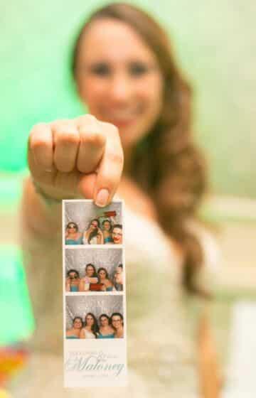 bride holding photo strip