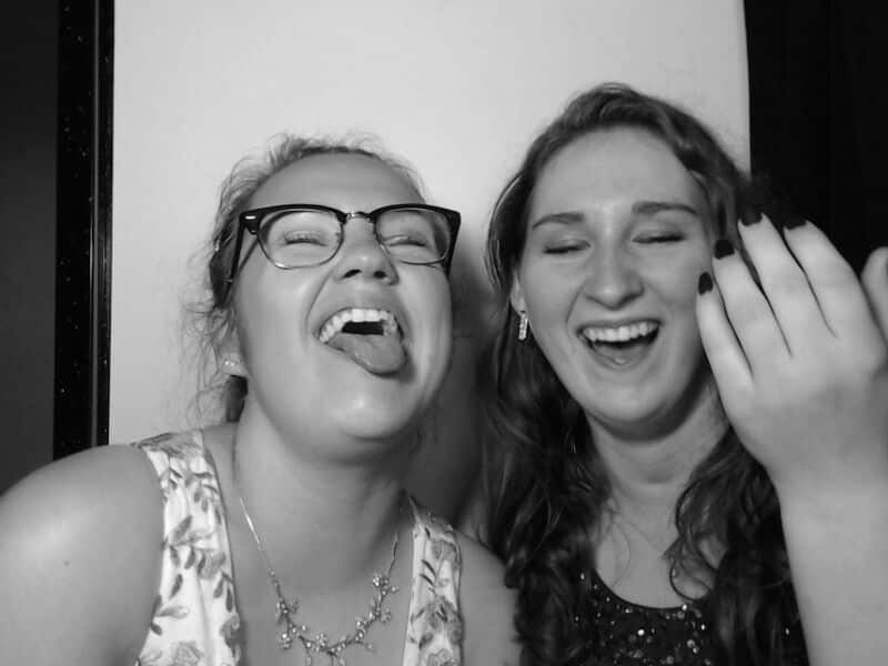 teens laughing in photo booth