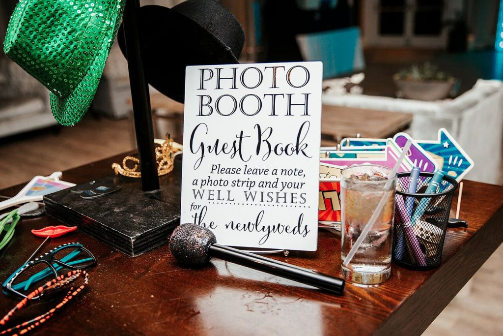 photo booth prop and guest book table