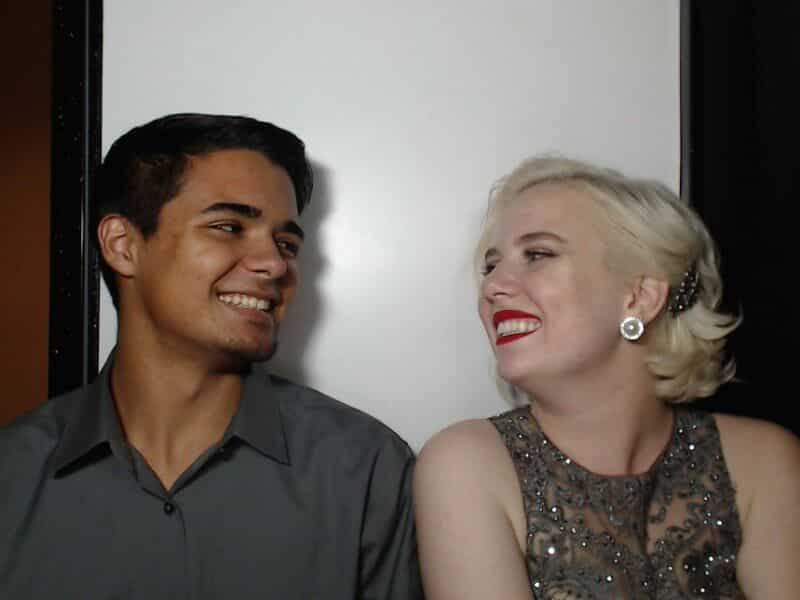 young man and woman smiling at each other in photo booth
