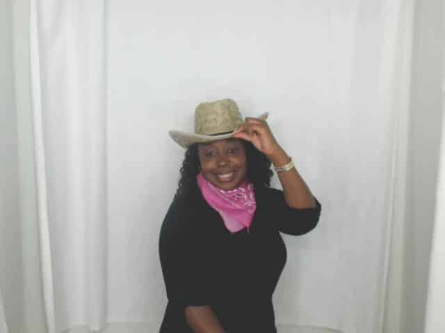 photo booth pose with cowboy hat and bandana