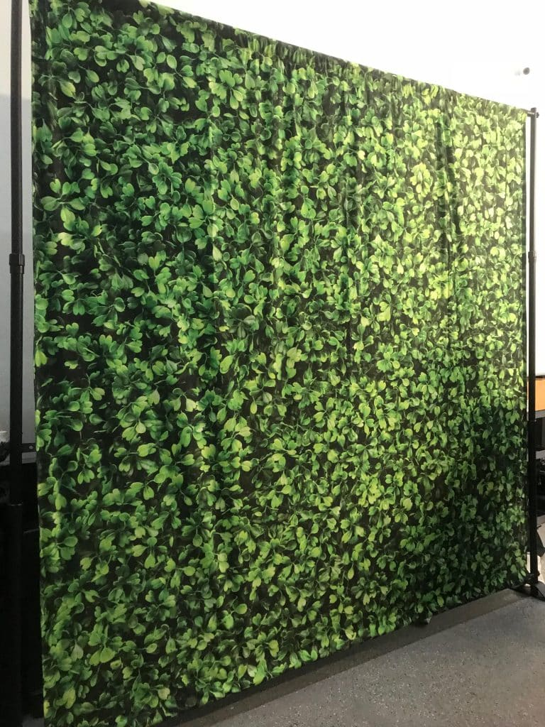 large fabric backdrop with vine print
