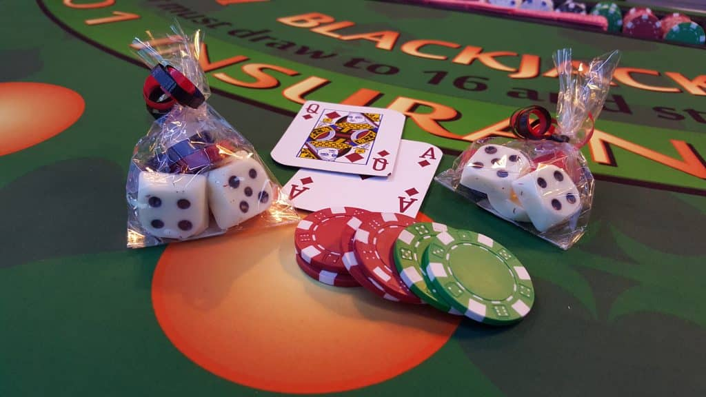 cards and poker chips on blackjack table