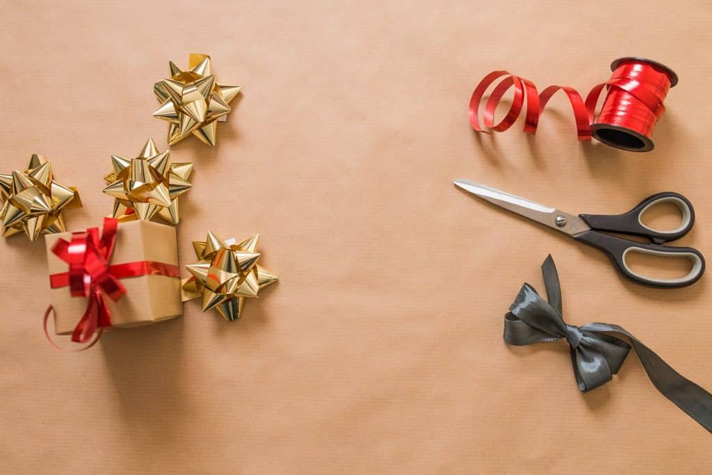flatlay of scissors, ribbon, and bows