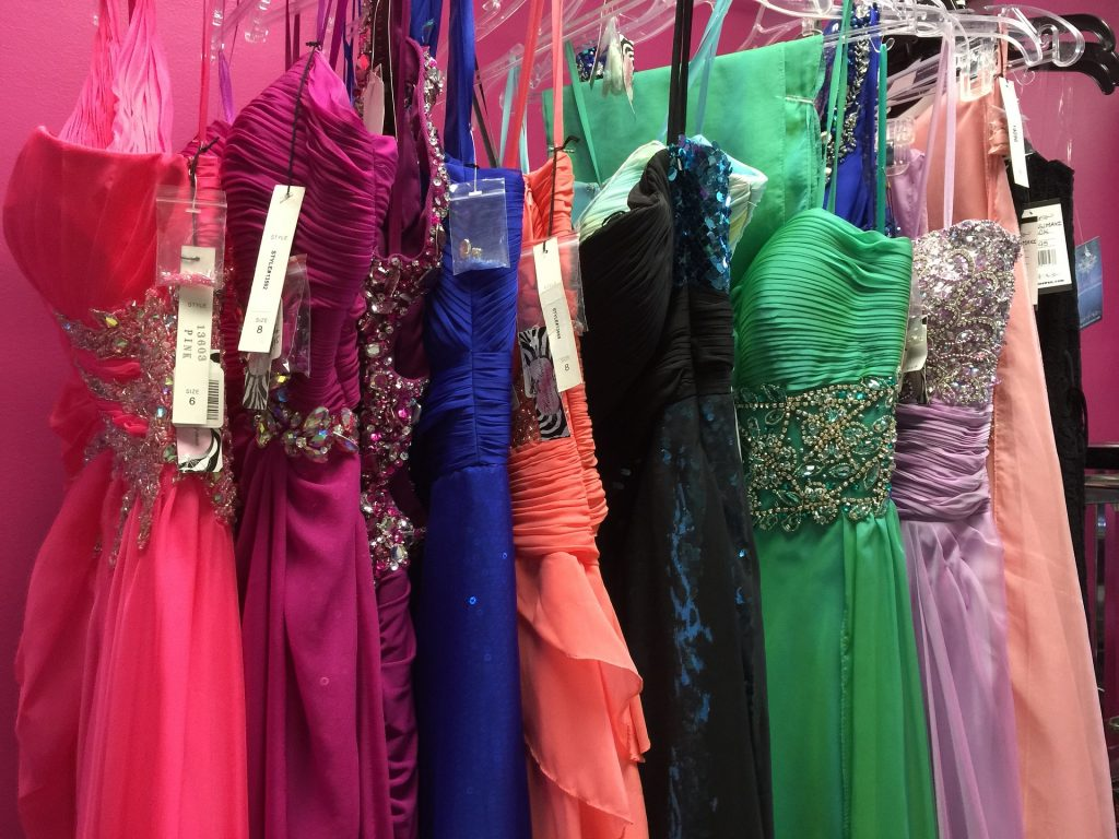 formal dresses hanging on clothes rack