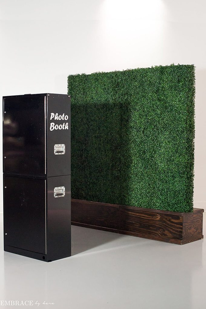 black open air photo booth and vine wall background