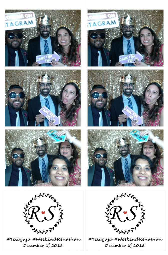 wedding guests in photo booth with props