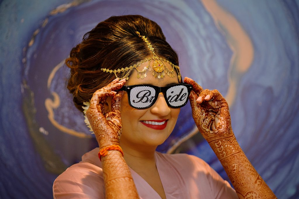 "Indian bride Rena wearing ""bride"" sunglasses"