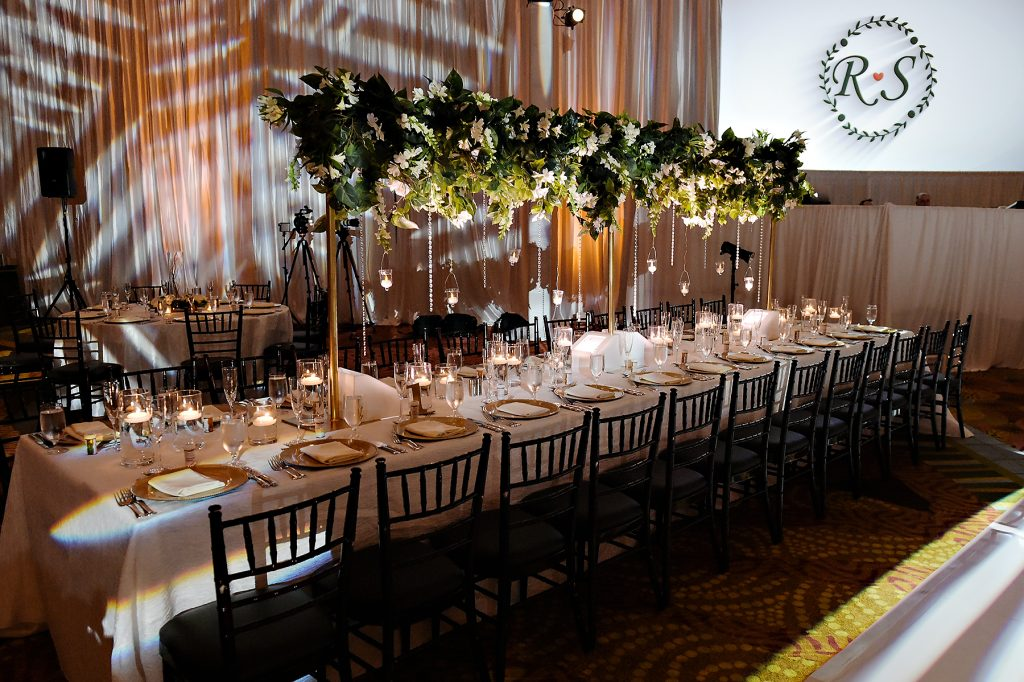 Long reception table with tall floral centerpiece