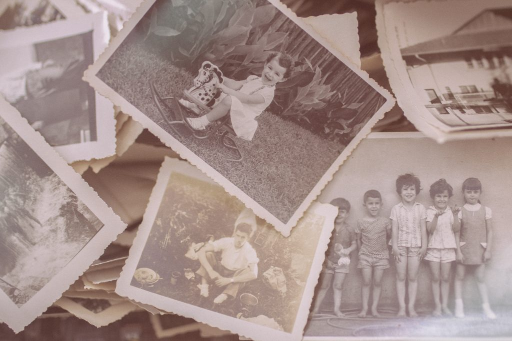 scattered collection of old family photos