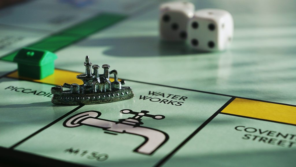 close up of water works on monopoly board game