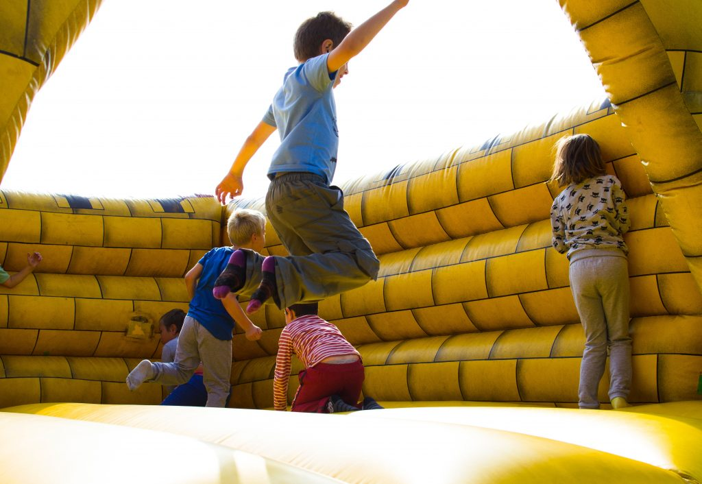 kids jumping in bounce house
