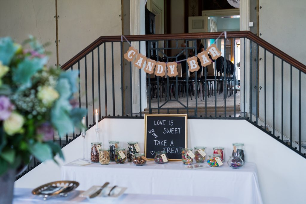 """Love is sweet"" candy bar at a wedding"
