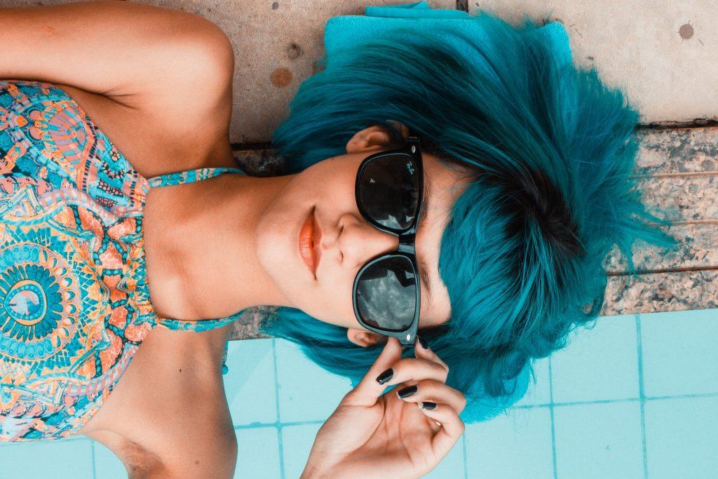 blue haired woman wearing sunglasses