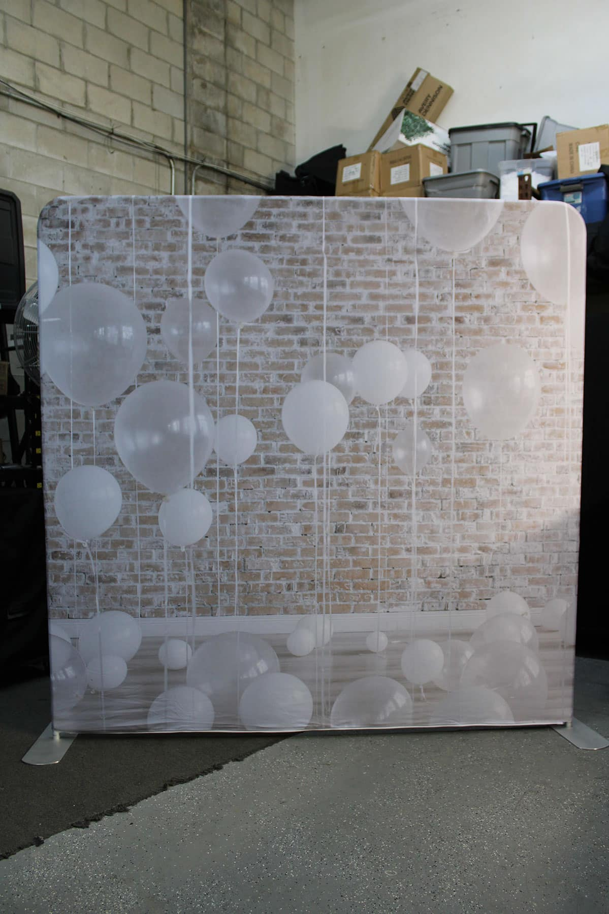 brick and balloons photo booth backdrop